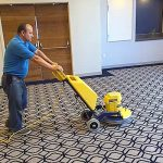 Cleaning a ballroom rug at the Mystic Hilton
